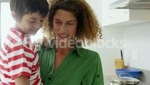 Happy mom and son cooking