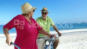 Senior couple going for a bike ride