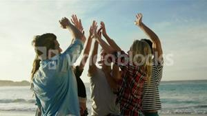 Group of friends doing high five