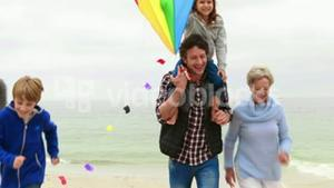 Happy family running with kite