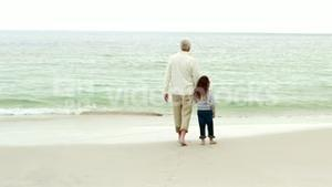 Grandfather and granddaughter walking together