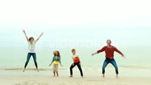 Smiling family jumping together