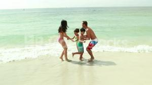 Family playing in water