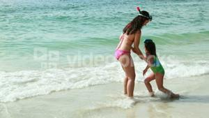 Mother and daughter playing in water