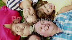 Extended family lying in circle