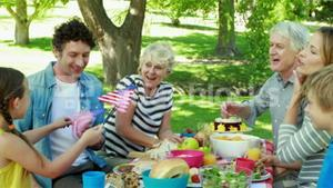 Family having picnic and holding american flag