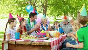 Boy having a birthday party with family