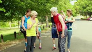 Athletic group running at the park