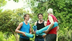 Athletic group with fitness mat