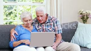 Senior couple doing video chat
