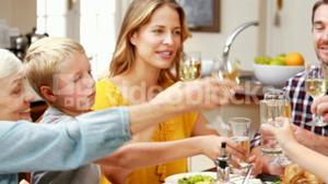 Family toasting at dinner