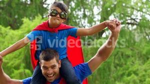 Father giving piggy back to son