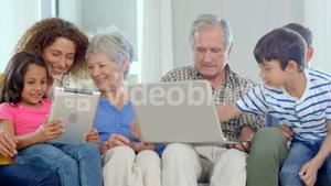 Family using laptop and tablet
