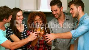 Friends toasting with beers and wine