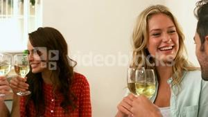 Friends toasting with white wine