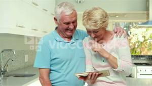 Senior couple using tablet pc
