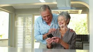 Senior couple using smart phone