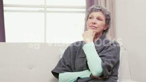 Thoughtful woman thinking with hand on chin