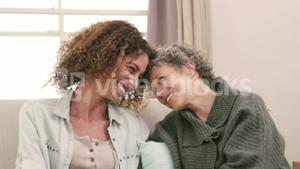 Smiling women with head to head