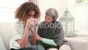 Woman comforting her friend crying