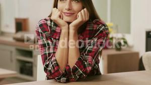 Thoughtful brunette with hands on chin