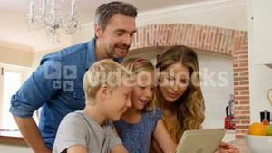 Smiling family using tablet