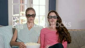 Scared women watching a 3D movie