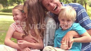 Happy family laughing in a park
