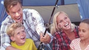 Happy family with a fishing rod