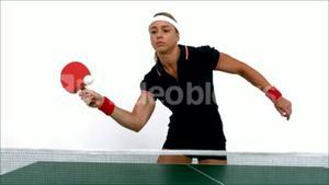 Female ping pong player hitting ball
