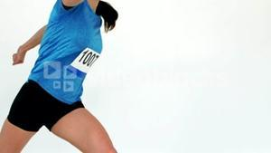 Female athlete running in a competition