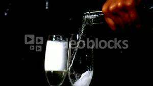 Woman pouring champagne into flute