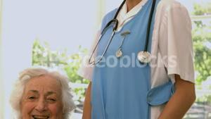Smiling senior woman with nurse