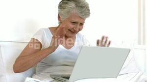 Senior woman doing a video chat