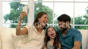 Family taking selfie together