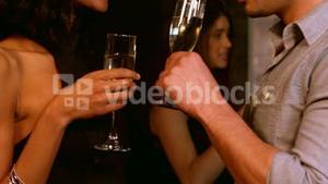 Cute couple toasting with champagne at a party