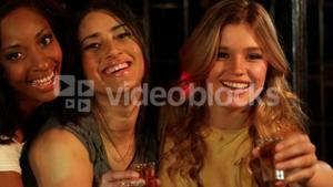 Cute friends having shots at a party
