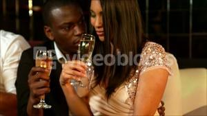 happy couple holding champagne