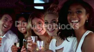 happy friends holding champagne