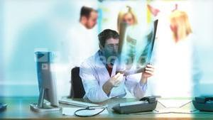 Doctor working at desk in Hospital