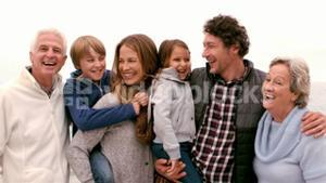 Family standing and laughing