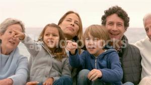 Family sitting and pointing