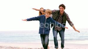 Family running with arms outstretched