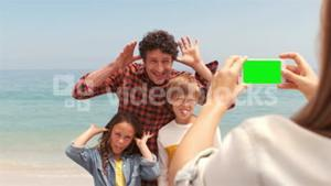Mother taking picture of her family