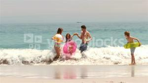 Family playing in the water
