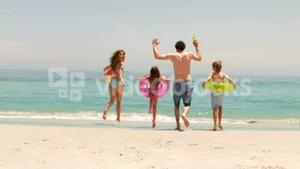Family running in the water