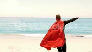 Man in wet suit dressed as superman