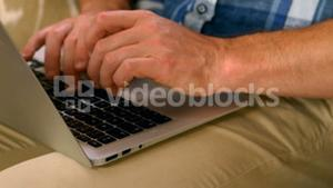 Masculine hands typing on a computer