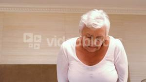 Old woman having a huge stomach pain