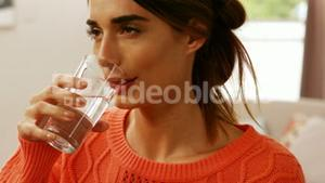 Woman drinking water in a glass